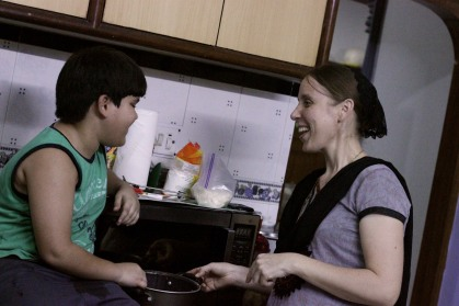 Jud and Becca making spaghetti sauce.